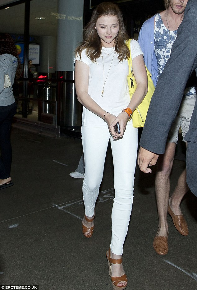 The white stuff: Chloe Moretz disembarked from a long flight at the Los Angeles International airport, on Sunday night