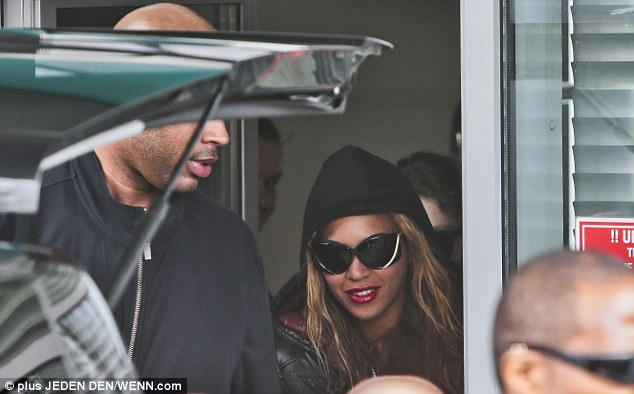 Next stop! Beyonce smiles as she arrives in Slovakia ready for yet another concert on her current Mrs Carter world tour