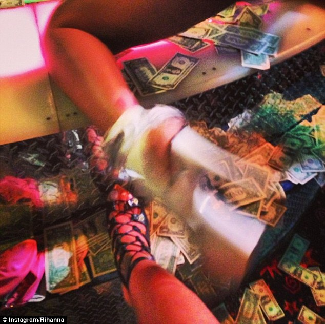 Green envy: The Unfaithful singer also tweeted on Saturday a snap of platform stilettos and dollar bills with the caption 'I still got my money #420'