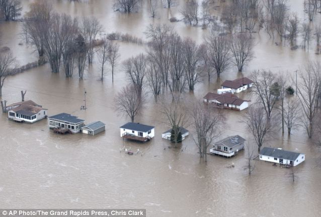 Floods: Homes in Robinson Michigan are completely engulfed by flood waters from the Grand River