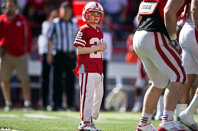 Inspiration: Earlier in April, Jack Hoffman, 7, who is fighting brain cancer, also scored a memorable touchdown with the Nebraska football team