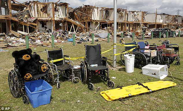 Abandoned: Wheelchairs sit outside devastated apartments