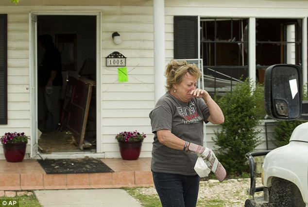 Shock: Dee Davlin cries after seeing her house in West, Texas, on Sunday. Her home was close to the fertilizer plant explosion and sustained heavy damage inside and out