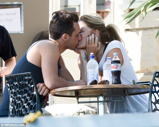 Pucker up: Charlotte Dawson was seen sharing a kiss with new man Tyrone Corban
