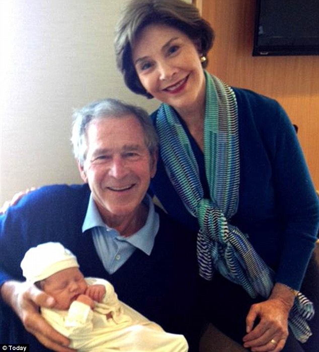 Proud grandparents: Former President George W Bush and his wife Laura pose with new granddaughter Mila