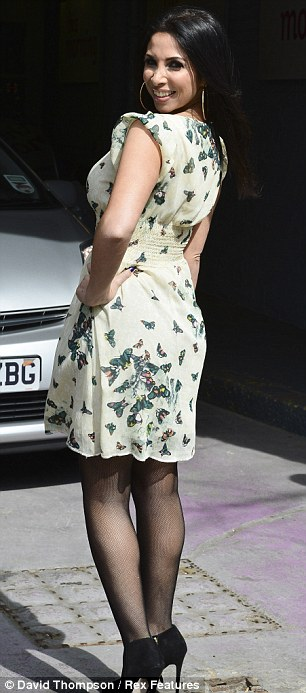 Her big moment: The aspiring star made the most of her TV appearance as she posed up a storm for the cameras in a pretty butterfly-print dress