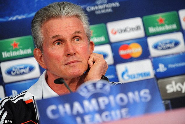 Top boys: Bayern captain Philipp Lahm and manager Jupp Heynckes (below) at a press conference on Tuesday