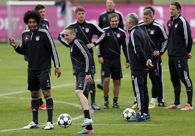 Talking tactics? Brazilian defender Dante and French forward Franck Ribery (left) exchange views in training