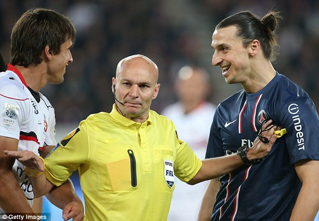 Enough of that: Referee Tony Chapron separated the duo after the scuffle