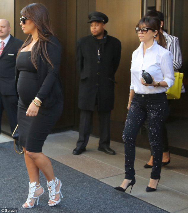 A family affair: Ahead of meeting up with Kanye, Kim had attended a meeting at the E! building with sister Kourtney and mother Kris Jenner