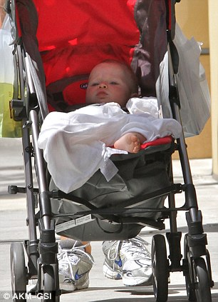 Chillin' with dad: Baby Faith looks very relaxed as she get's pushed around by her doting dad
