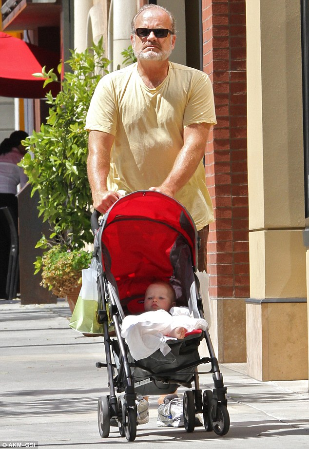 Easy rolling: Kelsey Grammer was spotted out with his young daughter Faith in Beverly Hills on Monday