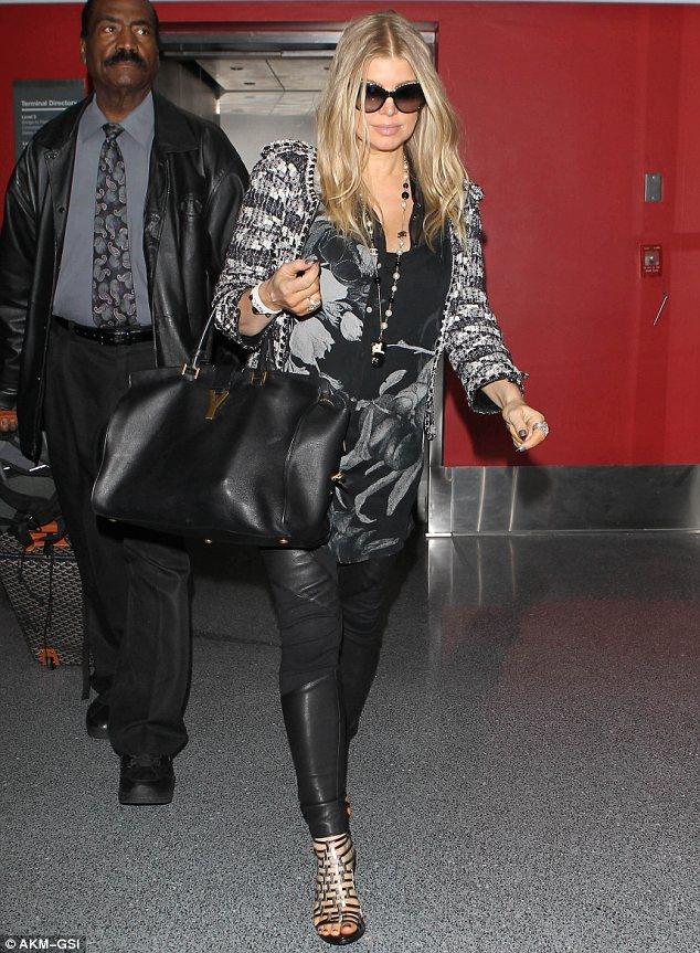 Lovely in leather: Pregnant singer Fergie wore a pair of leather trousers and high heels to catch a flight from Florida to LA on Monday