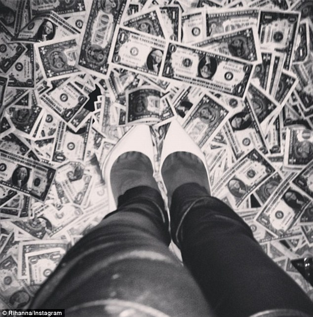 Yup that's real: The 25-year-old pop star later tweeted a snap of her leather trousers and white pumps amidst the dollar-littered floor of Magic City