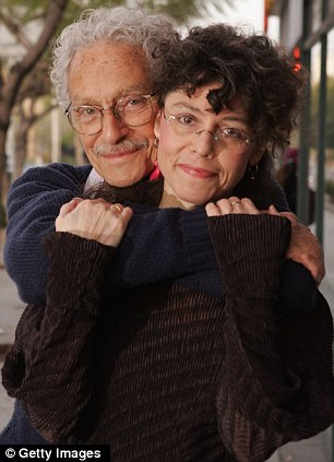 Family photos: Arbus posed for a photo with writer-photographer daughter Amy at her 2007 book signing in Beverly Hills