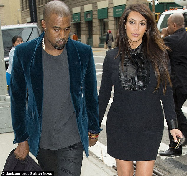 Short and sweet: Kim's enjoying her little black frocks at the minute