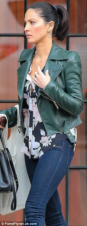 Floral fancy: Olivia softened the look with a floral blouse
