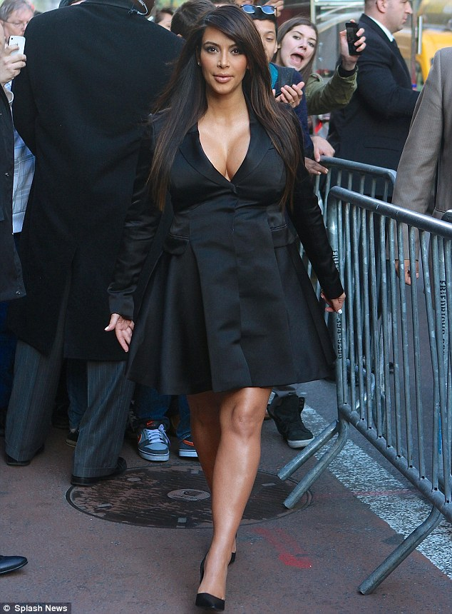 Busting out: Pregnant Kim Kardashian displayed ample cleavage in a black tuxedo-style coat dress as she attended the E! 2013 Upfront event at The Grand Ballroom at Manhattan Center in New York on Monday evening