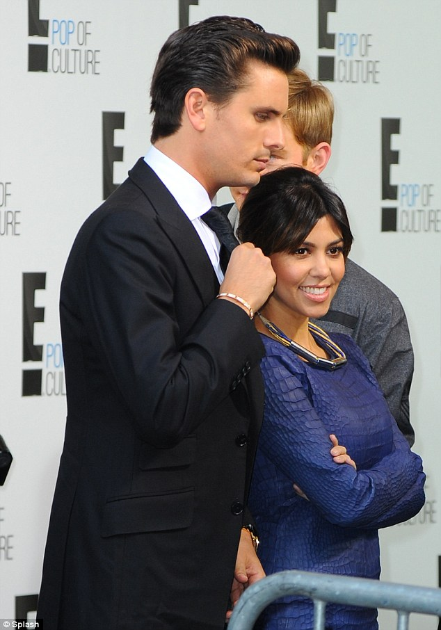 Doing what they do best: Kourtney and Scott answered questions as they made their way up the the press line