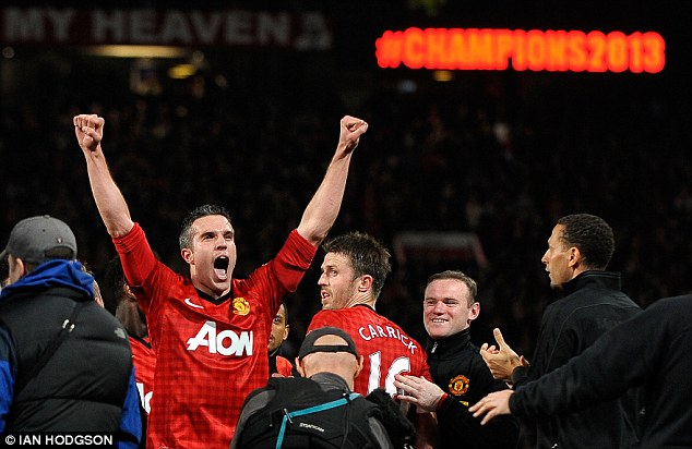 The main man: Robin van Persie celebrates after securing the title