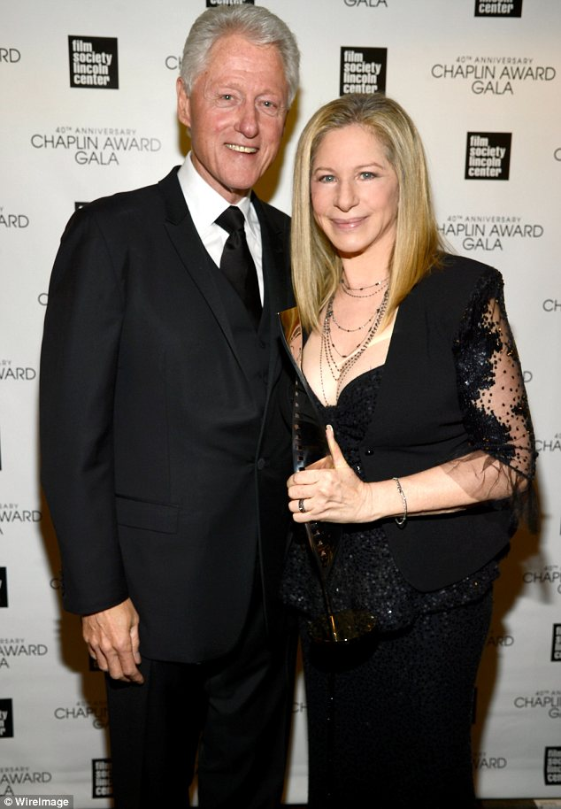 Making memories: Barbra posed backstage with former US President Bill Clinton, who presented her with her award