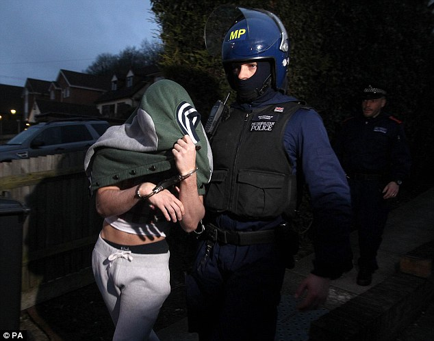 Raid: Police make an arrest during an early morning operation in response to recent football violence among Millwall fans at Wembley this month