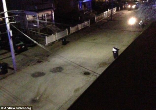 Site: This image shows a blast mark on the ground from where the pressure cooker bomb exploded