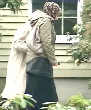 Katherine Russell, 24, leaves her family home with her lawyer Tuesday morning