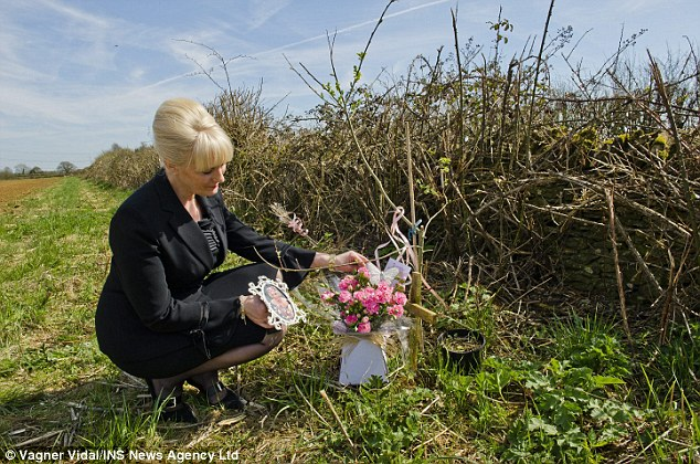 Campaign: Karen Edwards lays flowers at the crop field in Eastleech near the Oxfordshire border where her daughter's remains were found