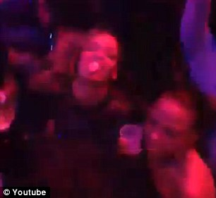 Making it rain: Strip club enthusiast Rihanna can be seen waving two massive stacks of one-dollar bills into the air Monday night in Atlanta in a just-uploaded YouTube video