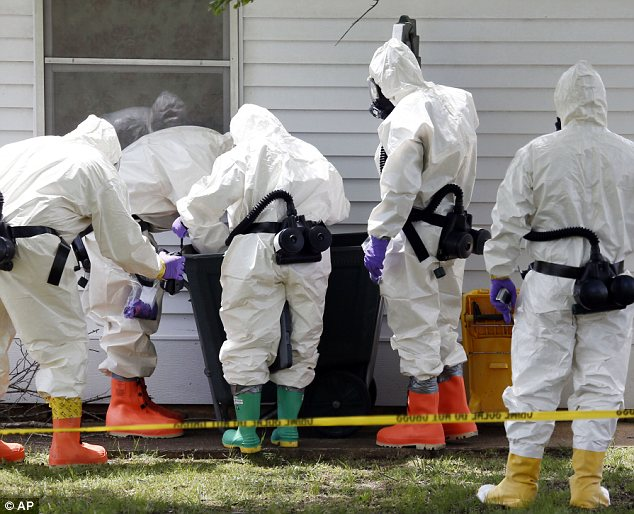 Federal agents wearing hazardous material suits inspected the trash outside the home of Paul Kevin Curtis, who was suspected of sending ricin-poisoned letters to President Obama AND  Sen. Roger Wicker