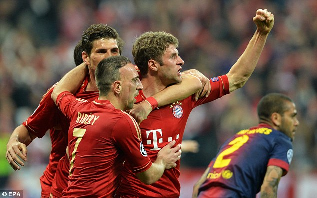 Going ahead: Thomas Mueller celebrates giving his side the lead