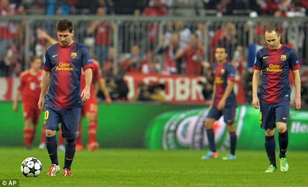 Feeling down: Barcelona forward Lionel Messi looks dejected