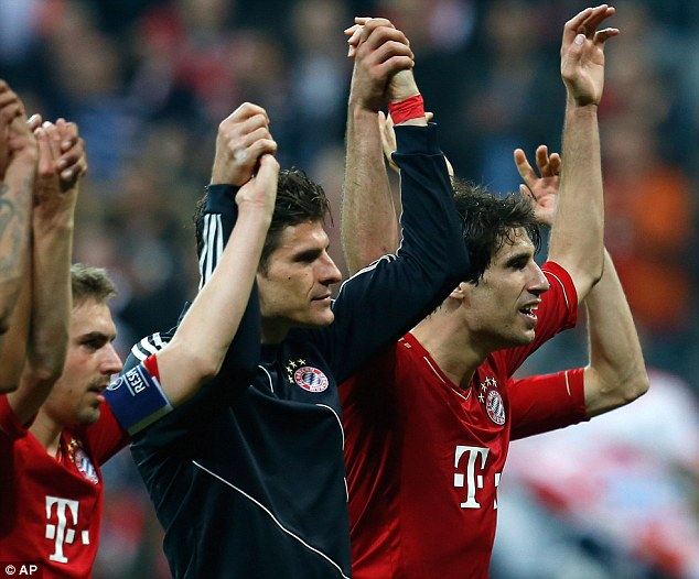 Heroes: Bayern players, with Mario Gomez centre, celebrate at the end of the game with their fans