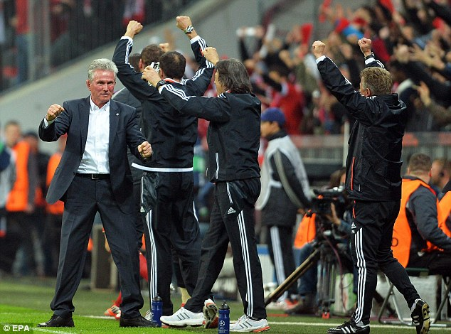Deserved: Munich's head coach Jupp Heynckes (left) celebrates with his coaching staff