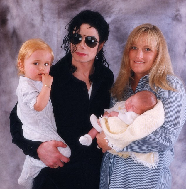 Family: Michael (holding Prince) and Debbie Rowe (holding Paris) were married for three years