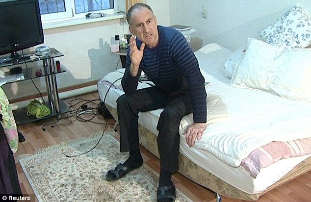 Dad: U.S. investigators traveled to southern Russia on Tuesday to speak to Mrs Tsarnaeva and the brothers' father Anzor, pictured, an American Embassy official said