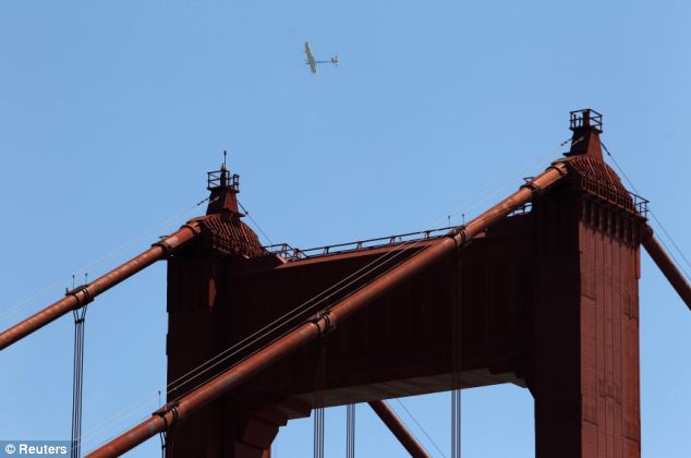 The Solar Impulse cross-country electric aircraft flies over the Golden Gate Bridge while doing maneuvers on Tuesday afternoon