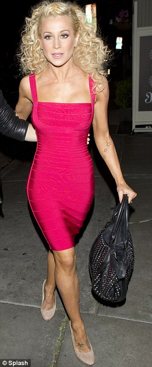 Dancing queen: Kellie Pickler showed off her stunning figure in a bright pink bodycon dress teamed with blonde hair extensions as she stepped out at STK restaurant in West Hollywood with dancer Mark Ballas on Tuesday night