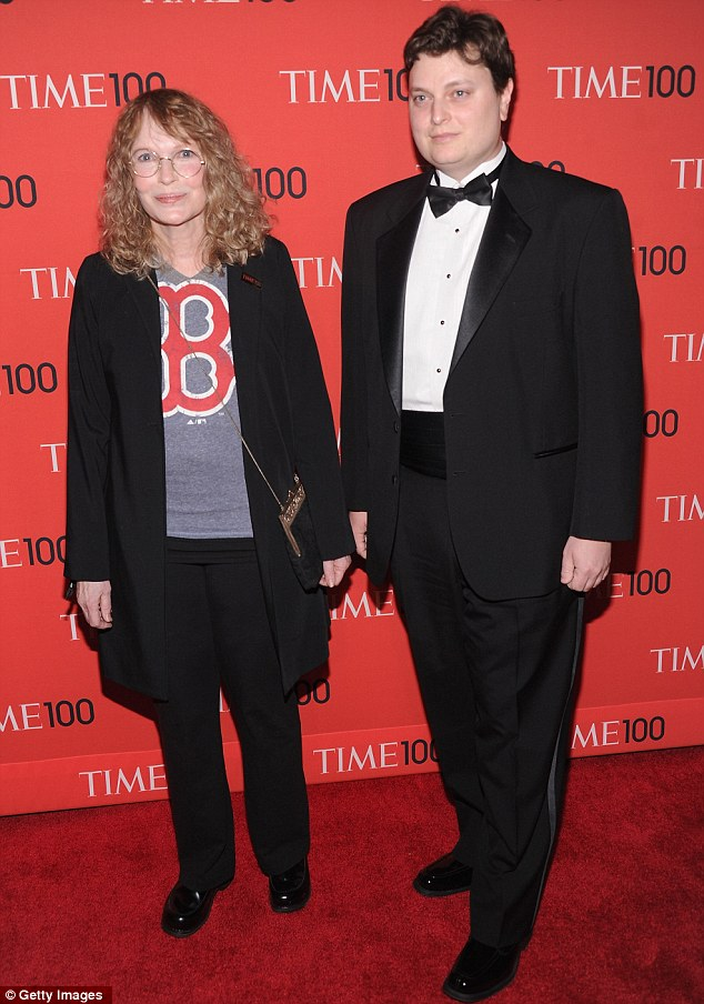 Dressed down: Actress Mia Farrow wore a Boston T-shirt while son Fletcher Previn was in a suit