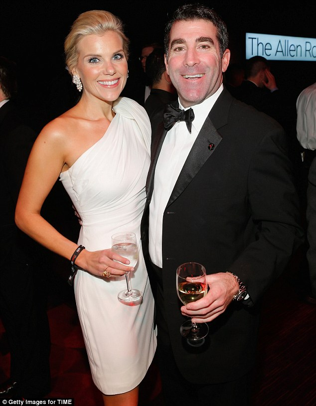 All smiles: Elizabeth Hartman and TIME, Inc. Publisher of News and Business Titles Jed Hartman enjoyed a drink