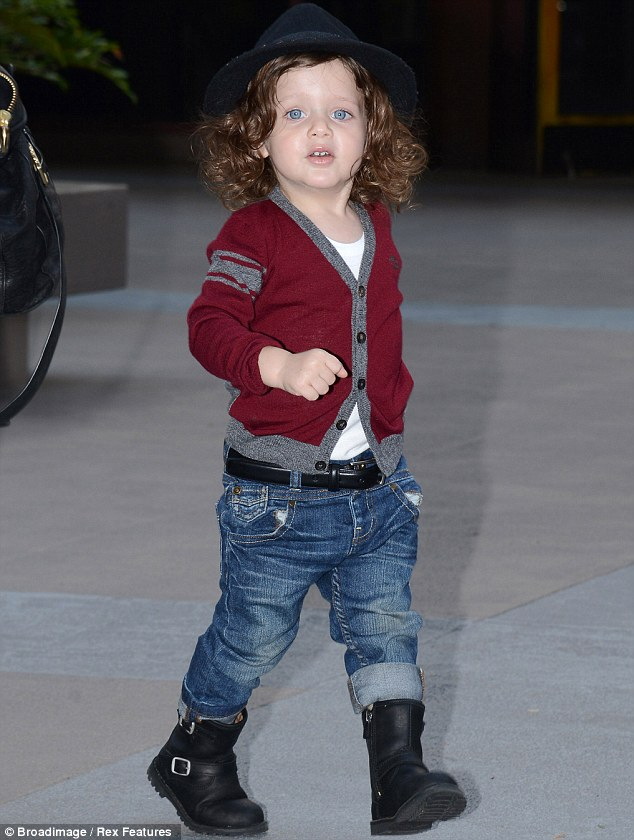 The norm: Pictured here in March, the toddler usually wears his long locks freely and down around his shoulders