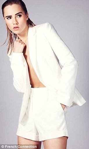 Suki wears stretch Zac blazer, £130, and Zac spring city shorts, £57