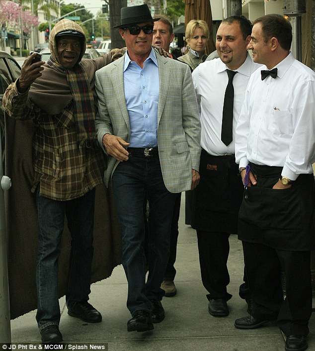 Matinee idol: These passersby could not help themselves when they saw Sylvester Stallone in Beverly Hills on Wednesday