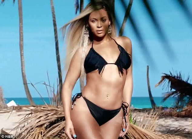 Looking great: Beyoncé writhes around on the dancefloor