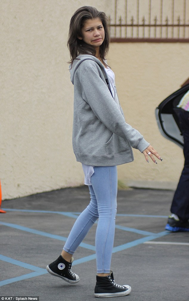 Playful: The DWTS favourite pulled a face as she showed off her slender figure in skinny jeans paired with a grey hoodie and converse trainers