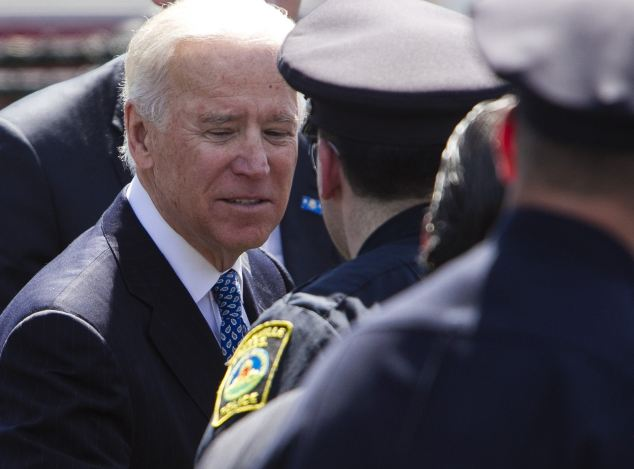 U.S. Vice President Joe Biden gives his respects to police officers at memorial services for officer Sean Collier, who authorities say was shot dead by the Boston Marathon bombing suspect