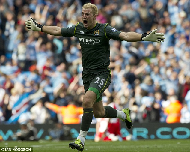 Joy: Joe Hart celebrates after Aguero ensure City beat Manchester United to the title on goal difference