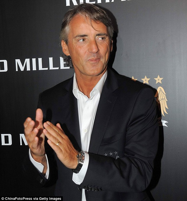 Stylish: Roberto Mancini shows off his Richard Mille watch before the start of this season