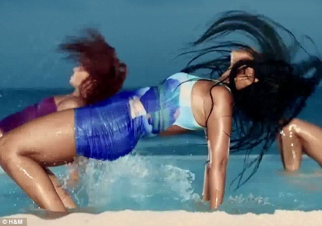 She can move! Beyoncé writhes about in the crystal clear waters in a clinging blue dress